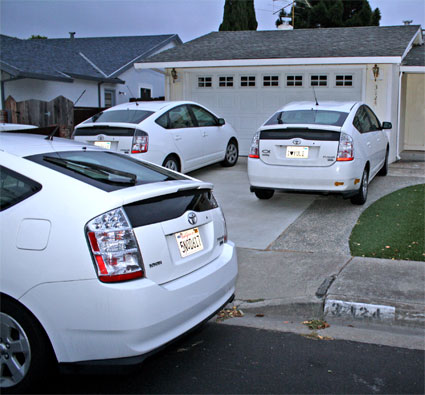 Three white Toyota Priuses at my Birthday Party at home